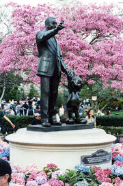 "Famous statue of Walt and Mickey, called ""Partners"", stands at the end of Main Street."