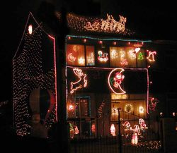 A house decorated for Christmas, illuminated with Christmas lights