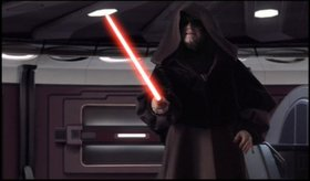 Darth Sidious ignites his red lightsaber.
