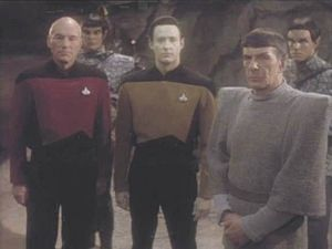 Jean-Luc Picard (Patrick Stewart) and Commander Data (Brent Spiner) standing with an older Spock in 2368.
